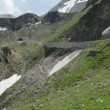 Tourists driving along Grossglockner road through alps. — Stock Video