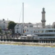 Stock Video: Warnemuende and parts of old town with light house and tepot as well as Neptune hotel.