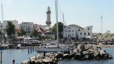 Warnemuende and parts of the old town with the light house and tea pot as well as the Neptune hotel. — Stock Video