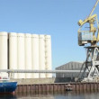 Stock Video: Grain port of Warnemunde and Rostock. ship lies at wharf for loading. In background, grain silos. Located at Warnemuende on August 02, 2013