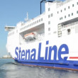 Stock Video: Ferry company StenLine leaves deep water port to Denmark. Located at Warnemuende on August 02, 2013