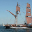 Stock Video: Two-masted sailing boat rides on Baltic Sea. People are board enjoy ride.