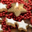 Christmas sweets like cinnamon pastry and candle with red pearls — Stock Video