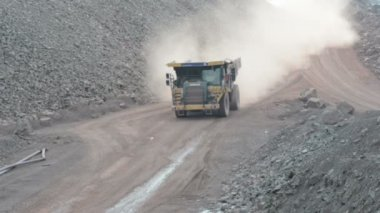 Dumper truck on road in surface mine quarry. — Stock Video