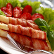 Asparagus and bacon. — Stock Photo