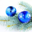 Branch of a blue spruce with blue ornaments. — Stock Photo #14504645