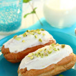Royalty-Free Stock Photo: Eclairs with pistachio cream on the blue