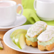 Eclairs with pistachio cream. — Stock Photo