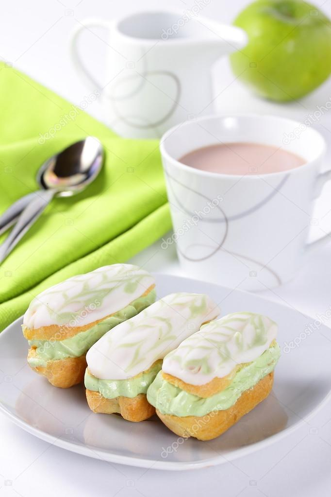 Mini eclairs with pistachio cream.  — Stock Photo #17648909