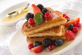 Waffles with honey. — Stock Photo