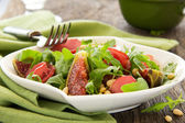 Light salad with figs, bacon, arugula and pine nuts. Selective focus. — Stock Photo