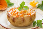 Rice porridge with pumpkin baked in a pumpkin. Selective focus. — Stock Photo