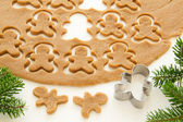 Gingerbread dough for Christmas cookies and cookie cutters. — Stock Photo