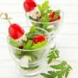 Salad with arugula, mozzarelland tomatoes. — Stock Photo #31039941