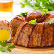 Meat roll with an Easter egg. — Stock Photo #31040591