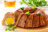 Meat roll with an Easter egg. — Stock Photo