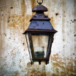 Stock Photo: Old lantern mounted on wall