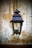 Old lantern mounted on a wall — Stock Photo