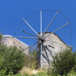 Old traditional windmill at Crete island in Greece — Stock Photo #12896052