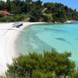 Scenic beach at Sithonia of Halkidiki peninsula in Greece - Stock Photo