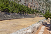 Ancient stadium at Delfi archaeological site in Greece — Stock Photo