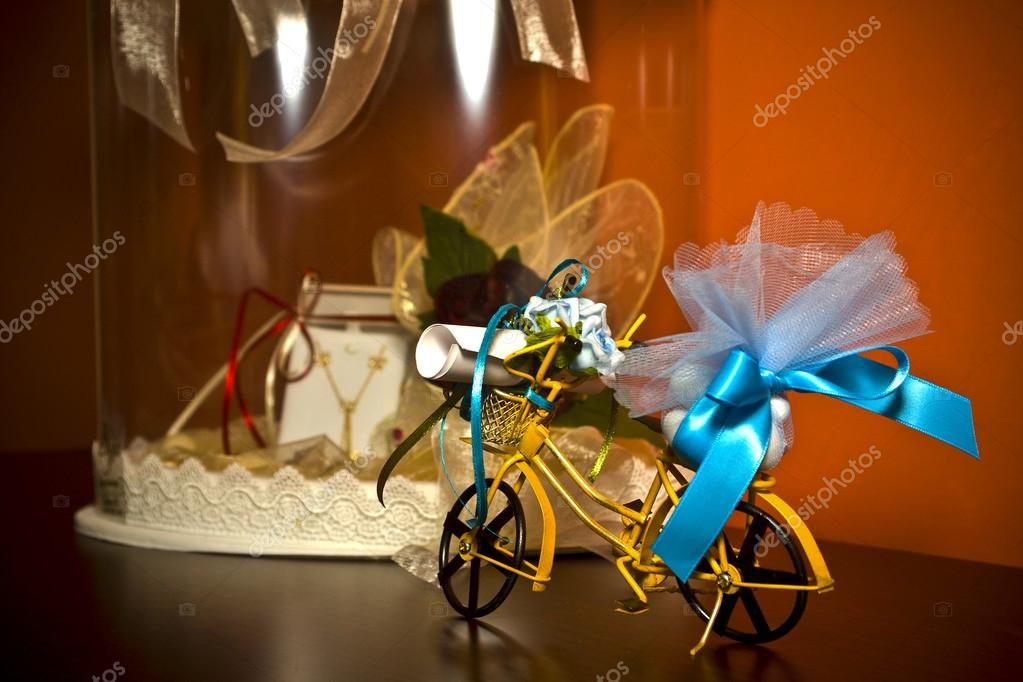 Bicycle miniature toy given as a present during a christening ceremony  — Stock Photo #13148022