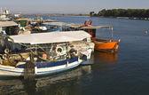 Greek wooden traditional fishingboats at Porto Lagos — Stock Photo