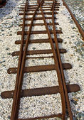 Old crossection of rails found at a railway station — Stock Photo