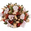 Decorative traditional wick basket with fake flowers in it - Stock Photo