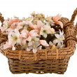 Decorative traditional wick basket with fake flowers in it — Foto de stock #13347814