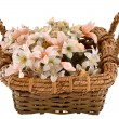 Decorative traditional wick basket with fake flowers in it — стоковое фото #13347814