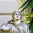 Greek classic era statue in front of a building in Greece — Stock Photo