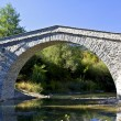 Stock Photo: Old alike stone bridge at Greece