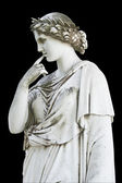 Statue on black showing a greek mythical muse — Stock Photo