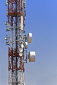 Communication tower with parabolic antennas — Stock Photo