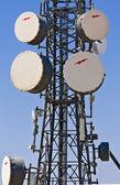 Communication tower with parabolic antennas — Stock Photo