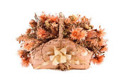 Decorative traditional wick basket with fake flowers in it — Stock Photo