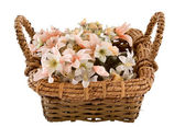 Decorative traditional wick basket with fake flowers in it — Стоковое фото