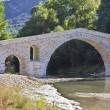 Old alike stone bridge at Greece — Stock Photo #13350704