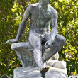 图库照片: Ancient greek statue in middle of garden