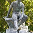 Foto de Stock  : Ancient greek statue in middle of garden