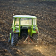 Tractor subsoiling field at fall season — Stock Photo