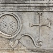 Old christian plaque with a cross relief on it - Stock Photo
