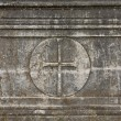 Old christian plaque with a cross relief on it — Stock Photo