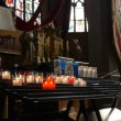 Stock Video: Candles in church Honfleur, France