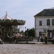 Stock Video: Rotating carousel in harbor of Honfleur, France