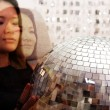 Royalty-Free Stock Photo: Japanese woman holds glitterball