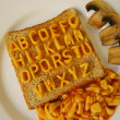 Alphabet on toast - Stock Photo