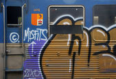 Close up of a graphitti sprayed train — Stock Photo