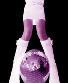Girls legs and glitterball — Stock Photo